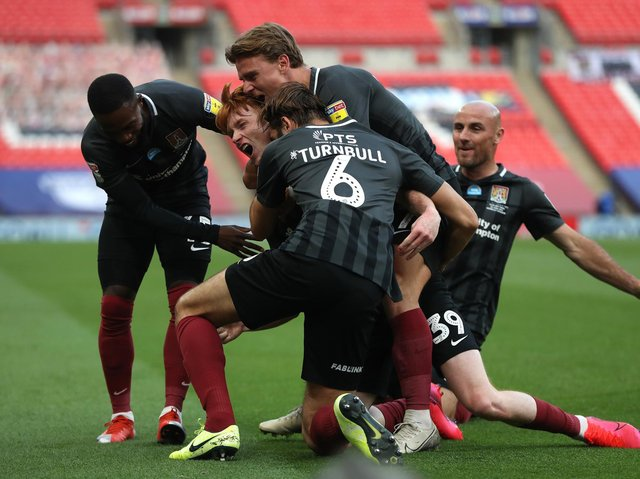 The Cobblers players were able to celebrate during the first half as Callum Morton gave them a 2-0 lead against Exeter City at Wembley