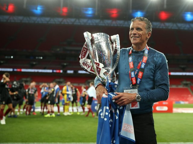 Cobblers boss Keith Curle was able to savour promotion at Wembley Stadium