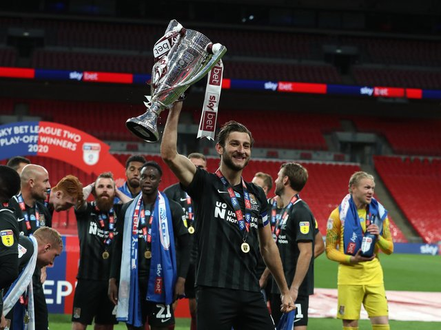 Charlie Goode was all smiles after steering Cobblers to Wembley glory