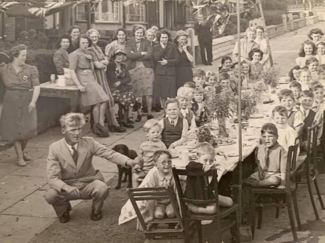 Emma (standing, left) at the celebrations with daughter Patricia, (sitting, fourth girl back).
