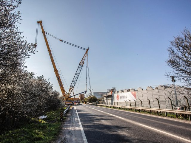 A 50m crane in use installing eight concrete beams for one of three railway link bridges in Northamptonshire.