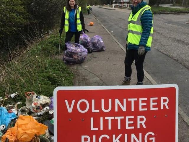 Volunteers get to work.