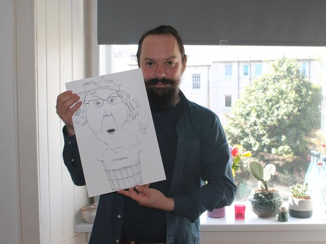 Tom with his fun portrait of Pam Rankin.
