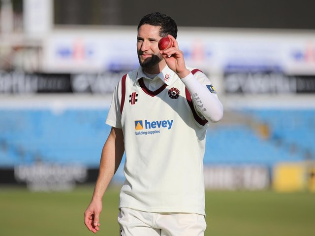 Wayne Parnell raises the match ball in celebration of his five-wicket haul for Northants (Pictures: Pete Short)