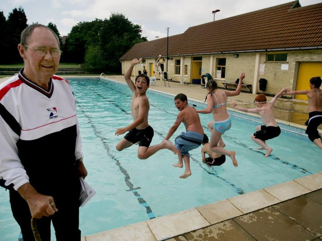 Our library picture of former campaigner BIll Spencer with local children at the pool.