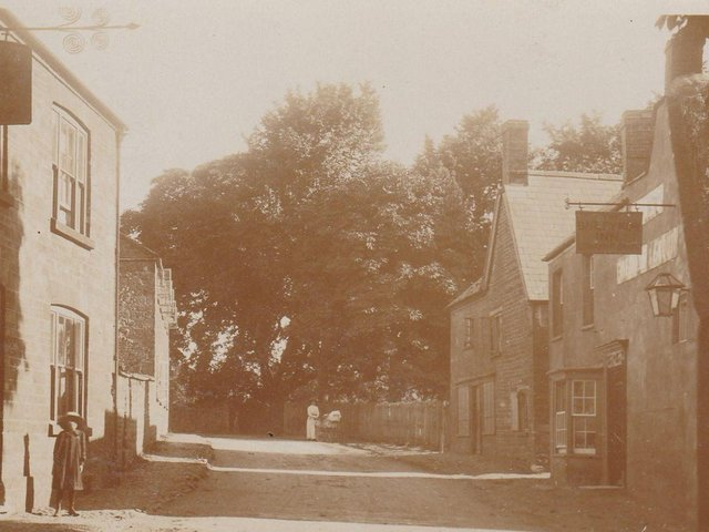 Watford 1906 showing the Henley Arms Pub on the left and The Barley Mow Pub on the right.