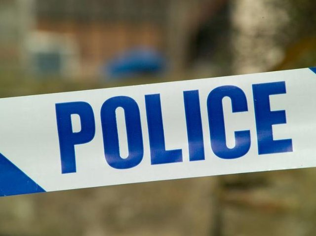 Police are holding a woman on suspicion of murder following last night's grisly discovery.