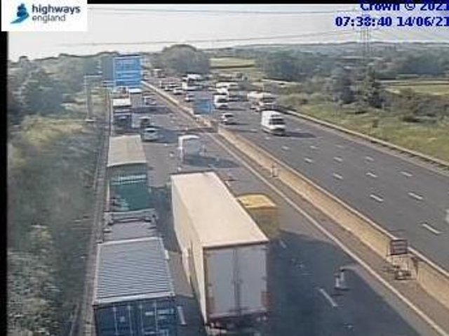 Traffic is crawling on the M1 after a vehicle fire blocked a lane near Northampton