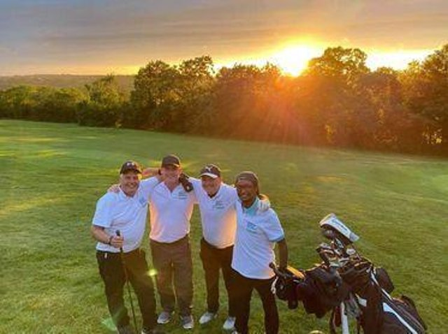 Mark Craig, Tom Gibbs, Kevin Everett  and Spencer Mabanga on the golf course.